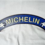 Curved Michelin Man Sign $10.50